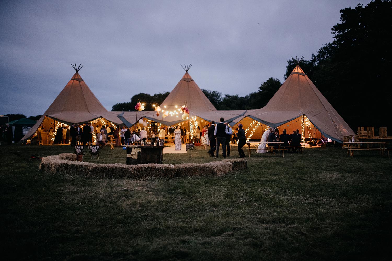 Night time tipi wedding lit up
